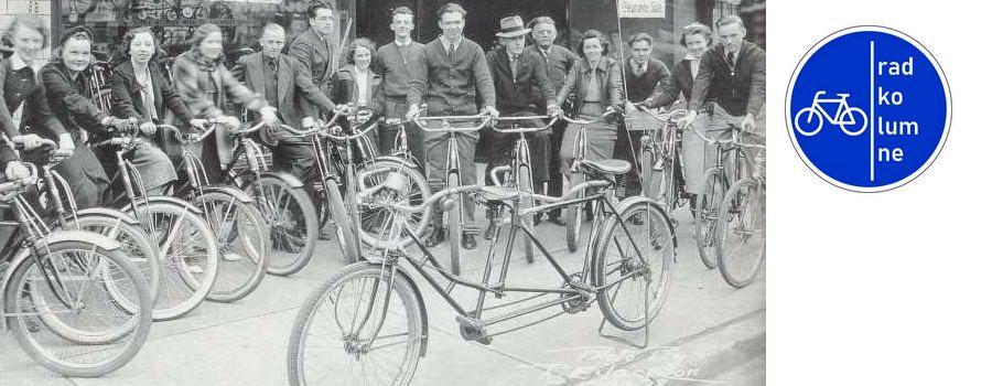 Historischea Foto: Radfahrer vor Geschäft